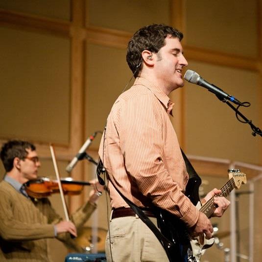 Pastor Daniel leading worship