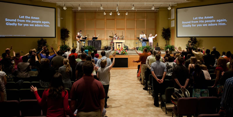 SGC auditorium - people singing and worshiping